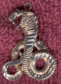 Gold and silver serpent charm.